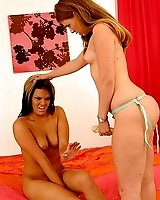 A hot blonde stuffs a Strapon in a hot babes asshole