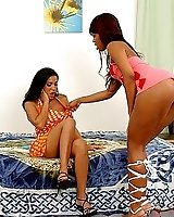 Ebony bitch fucks a sexy brunette in the asshole with starpon cock
