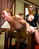 Prison girl submits to hard punishment by Dominatrix.
