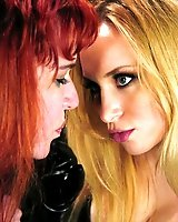 Sexy blonde dominatrix and submissive redhead.